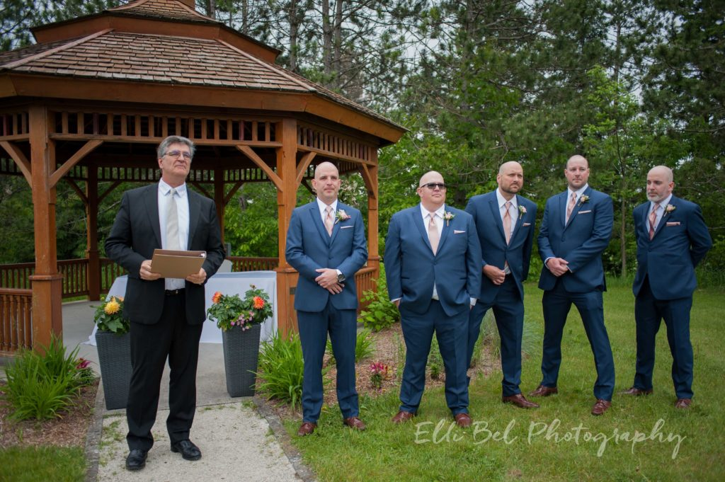 groom and groomsmen waiting at the altar